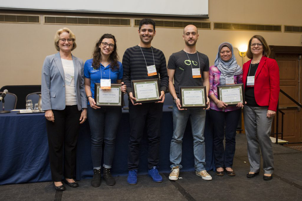 The four graduate student poster winners with Dr. Graham and Carol Lippincott